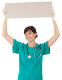 Woman doctor keeping  blank billboard Royalty Free Stock Photo