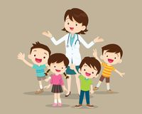 Woman doctor with kids happy Stock Photos