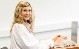 Woman doctor on a laptop Stock Photos