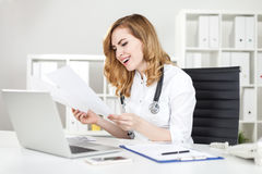 Woman doctor laughing Royalty Free Stock Photos