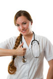 Woman doctor with long hair shows positive Royalty Free Stock Photo