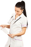 Woman doctor is looking cardiogram Stock Image