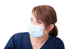 Woman doctor looking left and wearing mask Royalty Free Stock Images