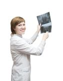 Woman doctor looking at x-ray Stock Photos