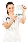 Woman doctor is looking roentgenogram Royalty Free Stock Photos