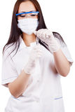 Woman doctor in a mask, goggles and rubber gloves holding capsules Royalty Free Stock Photography