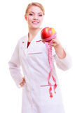 Woman doctor with measure tapes fruit. diet. Royalty Free Stock Photo