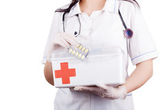 Woman doctor with a medical kit. Isolation. Royalty Free Stock Image