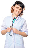Woman doctor in a medical lab coat with stethoscope. On a white background stock photo