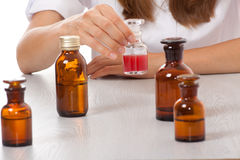 Woman doctor with medication in glass bottles Royalty Free Stock Photo
