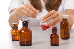 Woman doctor with medication in glass bottles Royalty Free Stock Photos