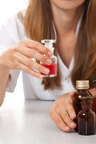 Woman doctor with medication in glass bottles Stock Photo