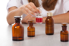 Woman doctor with medication in glass bottles Royalty Free Stock Image