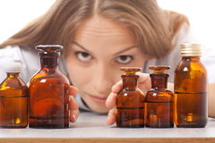 Woman doctor with medication in glass bottles Royalty Free Stock Photography