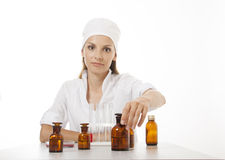 Woman doctor with medication in glass bottles Stock Photography