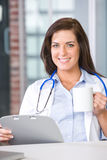Woman doctor in a modern office Stock Photos