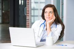 Woman doctor in a modern office Stock Images