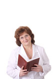 Woman doctor with notebook Royalty Free Stock Image