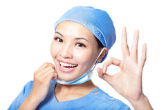 Woman doctor or nurse giving ok gesture Stock Photo