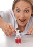 Woman doctor or nurse with medication in bottle Stock Photos