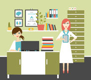 Woman doctor and nurse office workplace. Stock Photos
