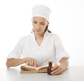 Woman doctor or nurse reading old book Royalty Free Stock Photos