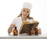 Woman doctor or nurse reading old book Royalty Free Stock Image