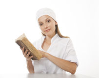 Woman doctor or nurse reading old book Royalty Free Stock Images