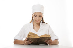 Woman doctor or nurse reading old book Stock Images