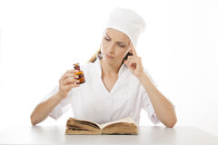 Woman doctor or nurse reading old book Stock Photo