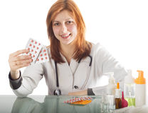 Woman doctor offering pill Stock Photo