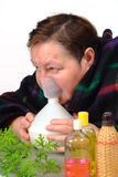 Woman doctor oneself  Inhalation therapy Stock Photography