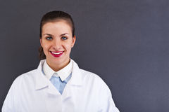 Woman Doctor over dark background Stock Photo