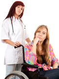 Woman doctor with patient on a wheelchair Stock Photo