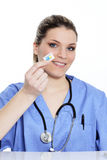Woman doctor and pill Royalty Free Stock Image