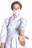 Woman doctor with a pill Stock Image