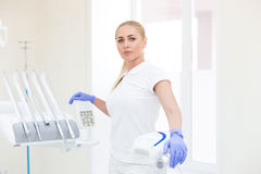 Woman doctor posing at her working place Stock Image