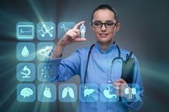 The woman doctor pressing buttons with various medical icons Stock Photo