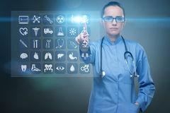 The woman doctor pressing buttons with various medical icons Royalty Free Stock Images