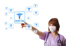 Woman doctor pressing digital button Stock Photo