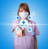 Woman doctor pressing digital button Royalty Free Stock Photos