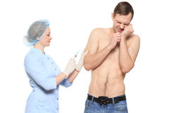 Free Woman Doctor Puts A Prick. The Man Is Afraid And Royalty Free Stock Image - 63037466