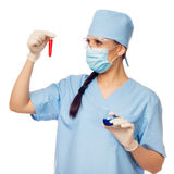 Woman doctor with red flask in their hands Stock Photography