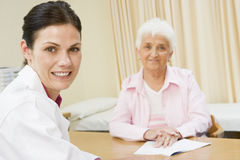 Woman in doctor's office Stock Photography
