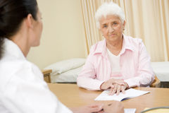 Woman in doctor's office Royalty Free Stock Photo