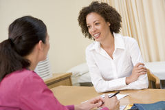 Woman in doctor's office Stock Image