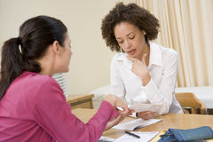 Woman in doctor's office Stock Images