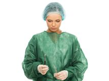 Woman doctor with scalpel Royalty Free Stock Images
