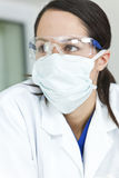 Woman Doctor or Scientist With Surgical Face Mask Royalty Free Stock Photography