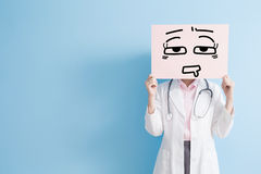 Woman doctor show tired billboard Royalty Free Stock Images